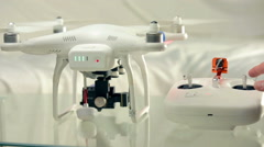 Trying out controllers for flying drone with spinning propellers - stock footage