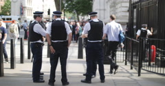 Police gather outside Downing st 4K Stock Footage