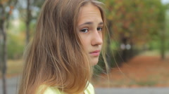 Young Girl In Autumn Park Sad Unhappy Face Portrait HD Stock Footage