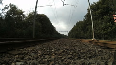 Train rides straight to the camera, low angle Stock Footage