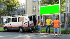 Broadcasting company and car - information board (green screen) - people Stock Footage