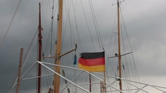 German flag in the wind in  port of Germany Stock Footage