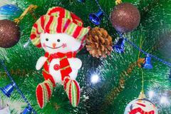 Amusing figure of a snowman on a christmas fir-tree.. Stock Photos