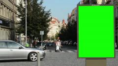 billboard in the city near road and buildings - urban street - green screen - stock footage