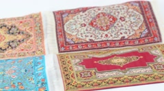 Appears and disappears bunch of oriental carpets. Stop motion. Stock Footage