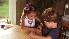 Boy and girl playing doctor together. Role playing. Using stethoscope Stock Footage