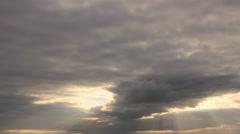 Sun lights on overcast sky Stock Footage