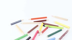 Pencils lined up appear, then disappear on a white. Stop motion. Stock Footage