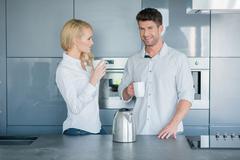 Attractive couple enjoying their morning coffee Stock Photos