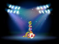 Stock Illustration of A clown doing some tricks at the center of the stage