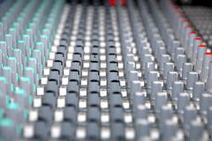 Audio mixing console in a recording studio. faders and knobs of a sound mixer Stock Photos