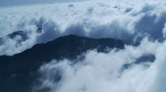 Clouds move quickly around the peaks Stock Footage