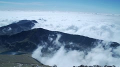 Mountain peaks shrouded in moving clouds -timelapse Stock Footage