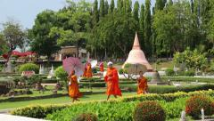 Buddhists on excursion in Mini Siam park in Pattaya, Thailand Stock Footage