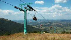People on cable road in carpathian mountains Stock Footage