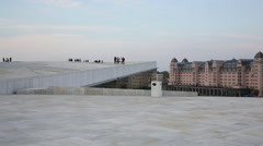 Opera house Oslo Norway view from roof cityscape in background Stock Footage