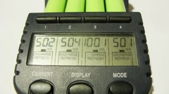 Batteries are charged in a special device, close-up of display Stock Footage