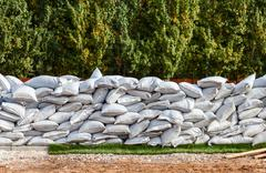 Sandbags for flood defense or military use Stock Photos