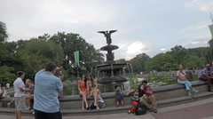Bethesda Statue Central Park Tourists Sculpture Wings Pond NYC 4K New York City Stock Footage
