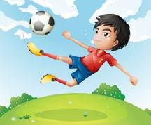 A football player in his red uniform kicking the ball - stock illustration