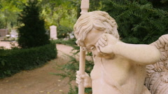 Crying angel statue on cemetary closeup Stock Footage