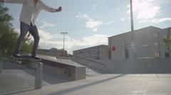 SLOW MOTION: Skateboarder boardslide on a rail Stock Footage