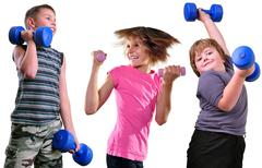Stock Photo of isolated portrait of children exercising with dumbbells
