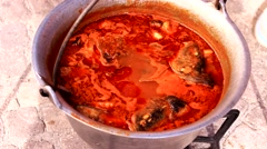 Goulash fish soup prepared boiled cooking in a pot 1920x1080 full hd footage Stock Footage