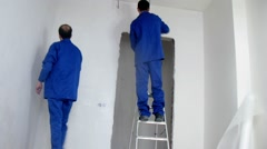Two workers applied plaster on the walls, time lapse Stock Footage