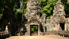 Stock Video Footage of Zoom Out of Entrance to Abandon Temple  - Angkor Wat Temple Cambodia