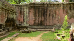 Stock Video Footage of 180 Degree Pan of Abandon Temple Archway and Courtyard - Angkor Wat