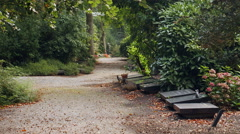 Gravel path and gravestones on cemetary Stock Footage