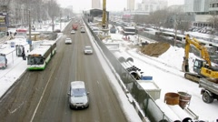 Traffic near reconstruction of the road ai winter, time lapse Stock Footage