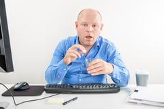 Sick and overworked office worker taking pill - stock photo