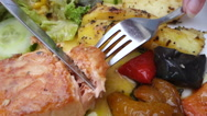 Stock Video Footage of eating grilled salmon , vegetables and potato