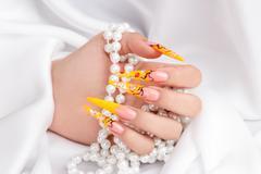 Manicured female hand Stock Photos