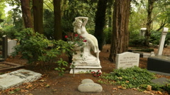 Tombstone of woman figure with red roses Stock Footage
