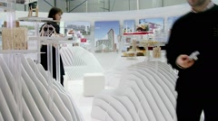 Stock Video Footage of People look at architectural models on exhibition