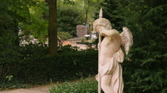 Crying angel statue on cemetary Stock Footage