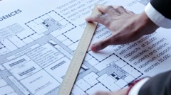 Builder measures the dimensions - stock footage