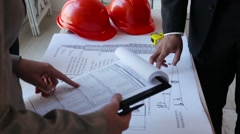 Builders and architect meeting together - stock footage