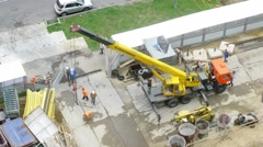 Workers work on a construction site near highway with traffic Stock Footage