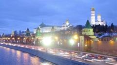 Cars at Kremlin embankment and Grand Kremlin Palace Stock Footage