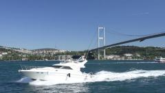 White luxury yacht are navigating with full speed at Istanbul Bosporus Edge Stock Footage