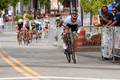 Cyclist separates himself from pack in criterium event Stock Photos
