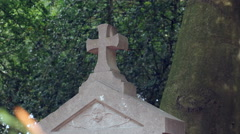 Stone cross on tombstone Stock Footage