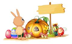 A rabbit, easter eggs, a pumpkin and an empty signboard Stock Illustration