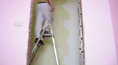 Two workers make decorative plaster on the walls Stock Footage