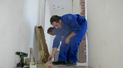 Two workers were laid the parquet floor in corridor, time lapse Stock Footage