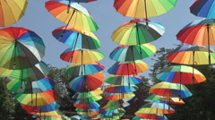 Multicolored umbrellas place in an amusement park. Stock Footage